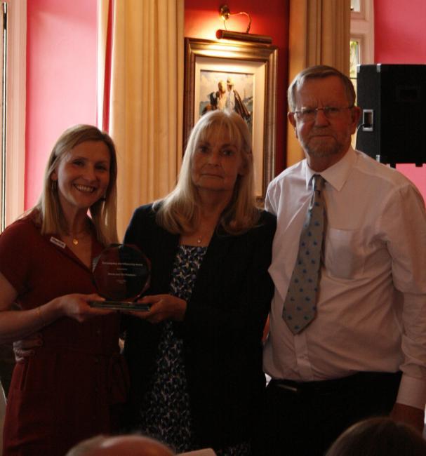 Phaedra Perry presents award to Shona and Tim Freeborn